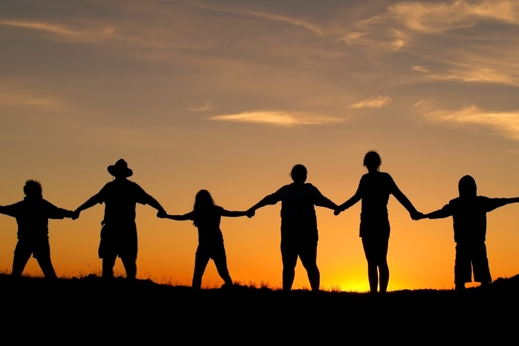 Many people join hands to represent a family unity.